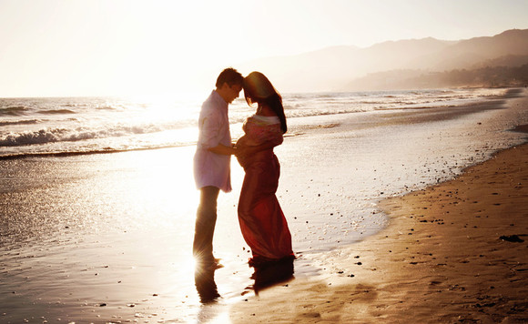 couple_sunset_beach_maternity_photograph.jpg