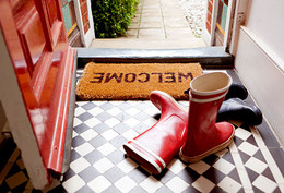 getty_rf_photo_of_boots_next_to_welcome_mat.jpg